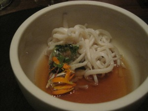 """Noodle"" in a dashi broth. We think the noodle was something like squid. Really tasty."